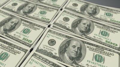 stacked dollar bills hundreds